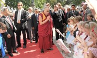 His Holiness the Dalai Lama welcomed in front of Hotel by kids playing flutes. Photo: