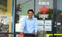 Political party founder Tenzin Rabgyal in front of his chemist shop in Dharamshala, near the Central Tibetan Administration. Photo: TPI