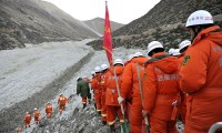 Rescuers on Saturday headed to the disaster site to search through debris at a gold mine after a mudslide in the Gyama Valley in Tibet on Friday buried 83 people. Photo: Color China Photo, via Associated Press