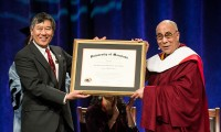 President of the University of Maryland Dr Wallace Loh presents His Holiness the Dalai Lama with an Honorary Degree of Doctor of Humane Letters at the University of Maryland in College Park, Maryland on May 7, 2013. Photo/Mike Morgan